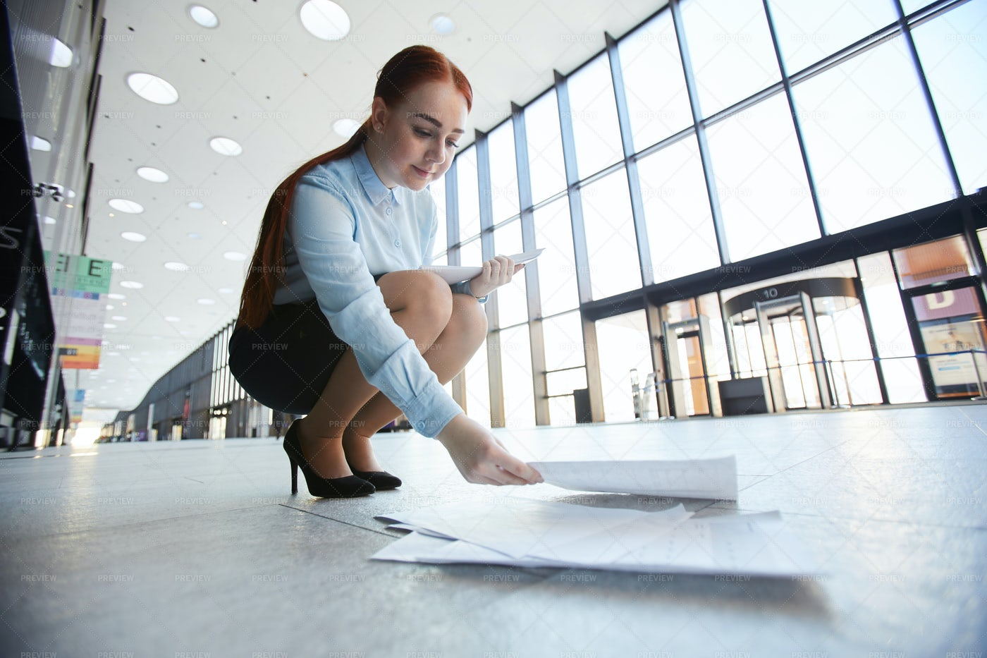 Businesswoman Picking Up Papers: Stock Photos