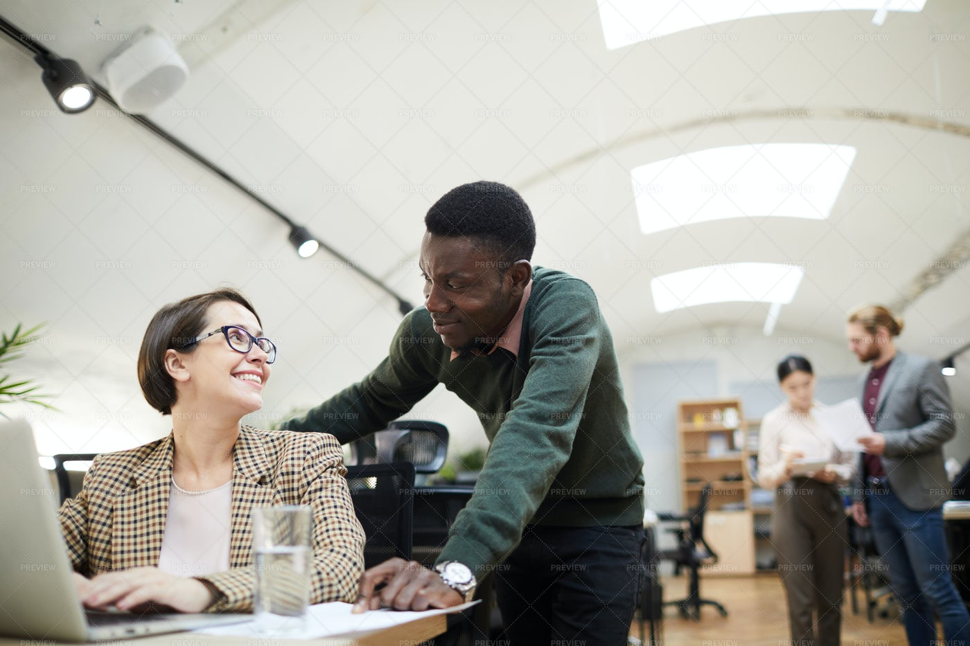 Two Business People Smiling At Each...: Stock Photos