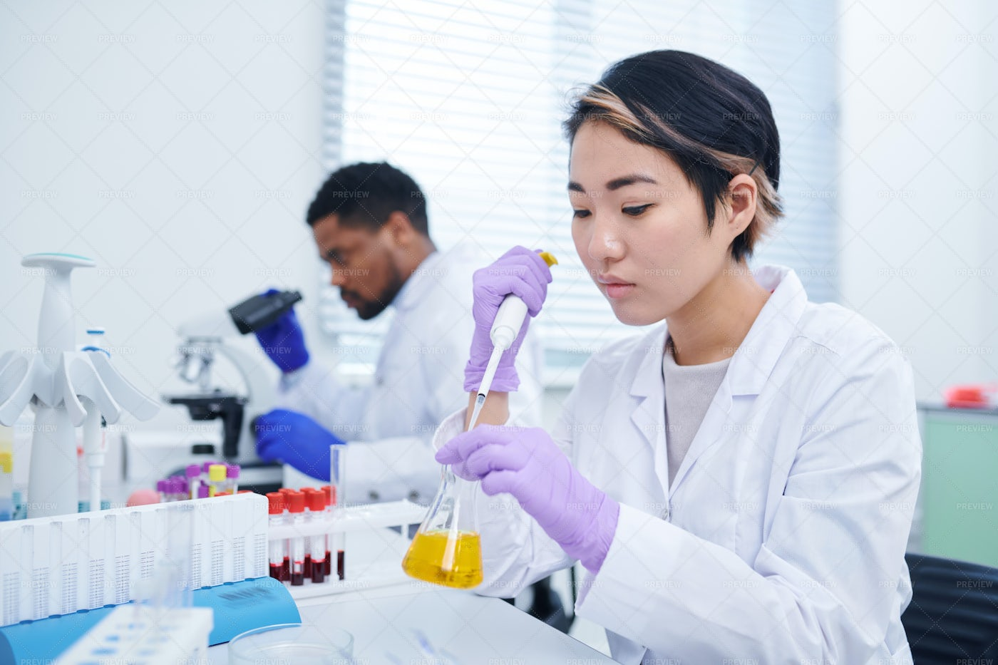 Lab Technician Testing Sample: Stock Photos