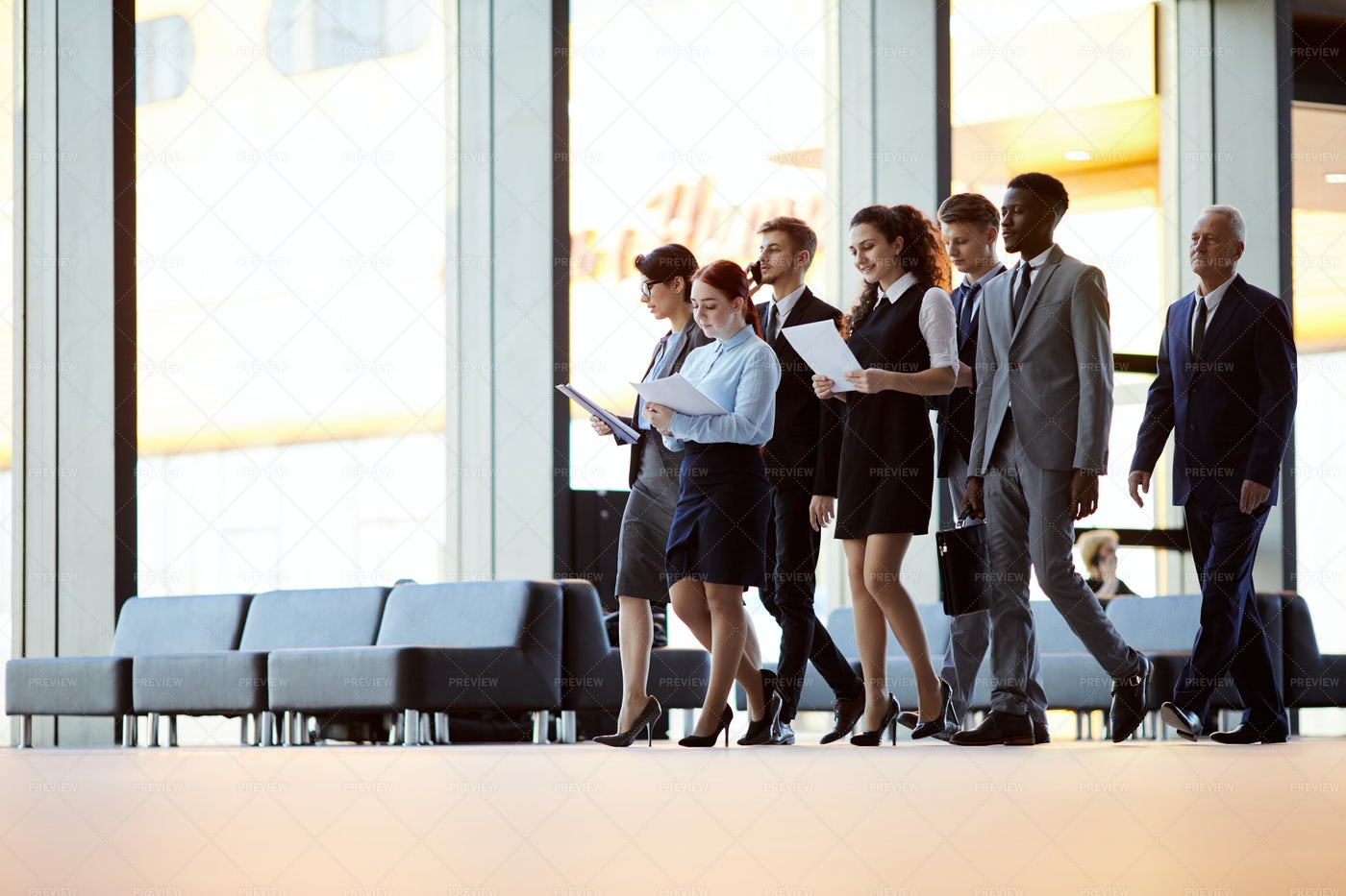 Office Workers Crossing Hall: Stock Photos