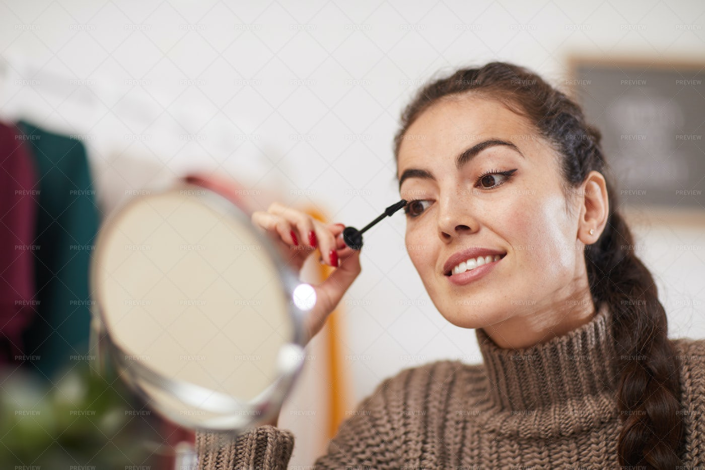 Young Woman Doing Makeup: Stock Photos