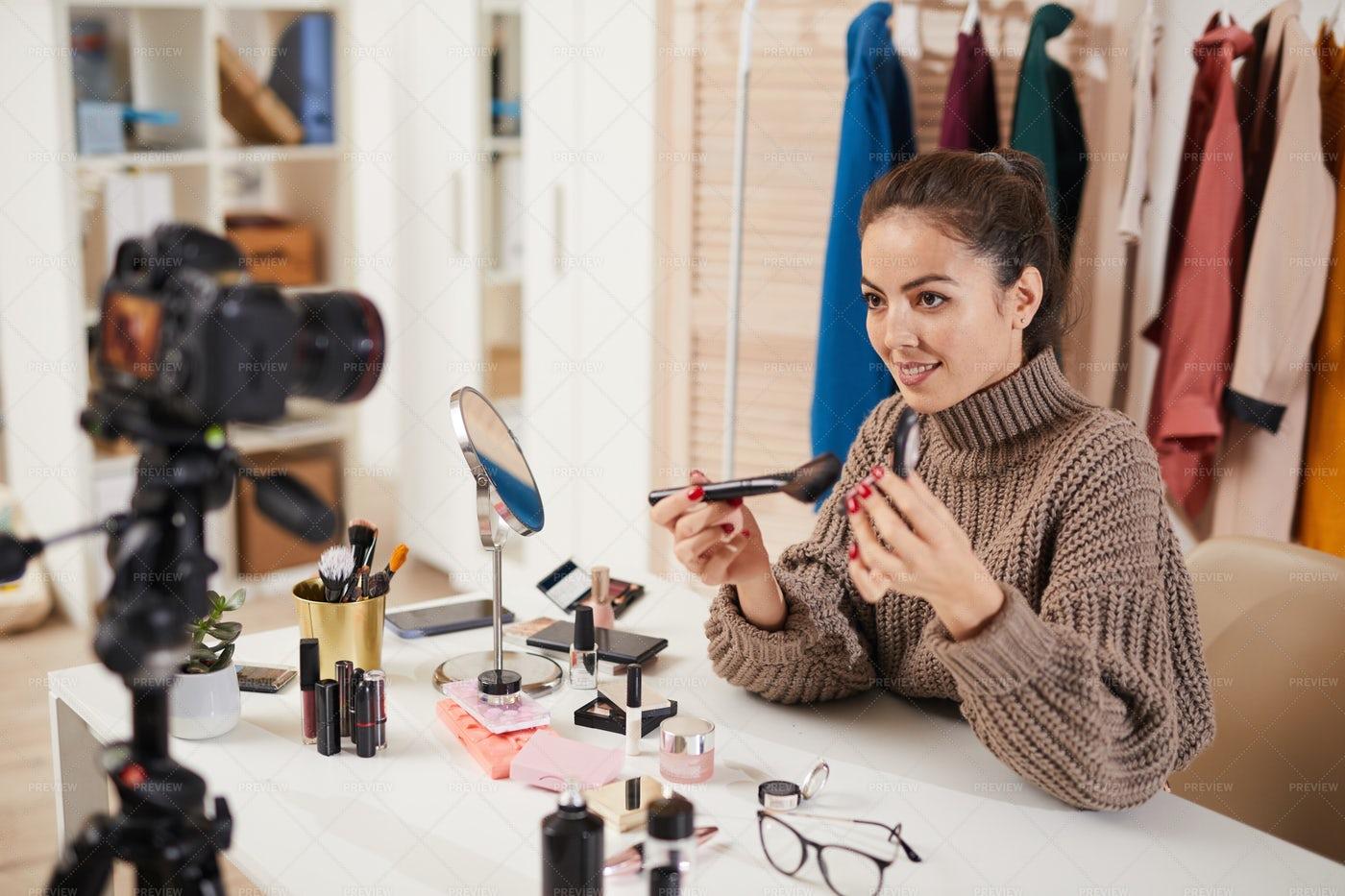 Young Woman Recording Makeup...: Stock Photos