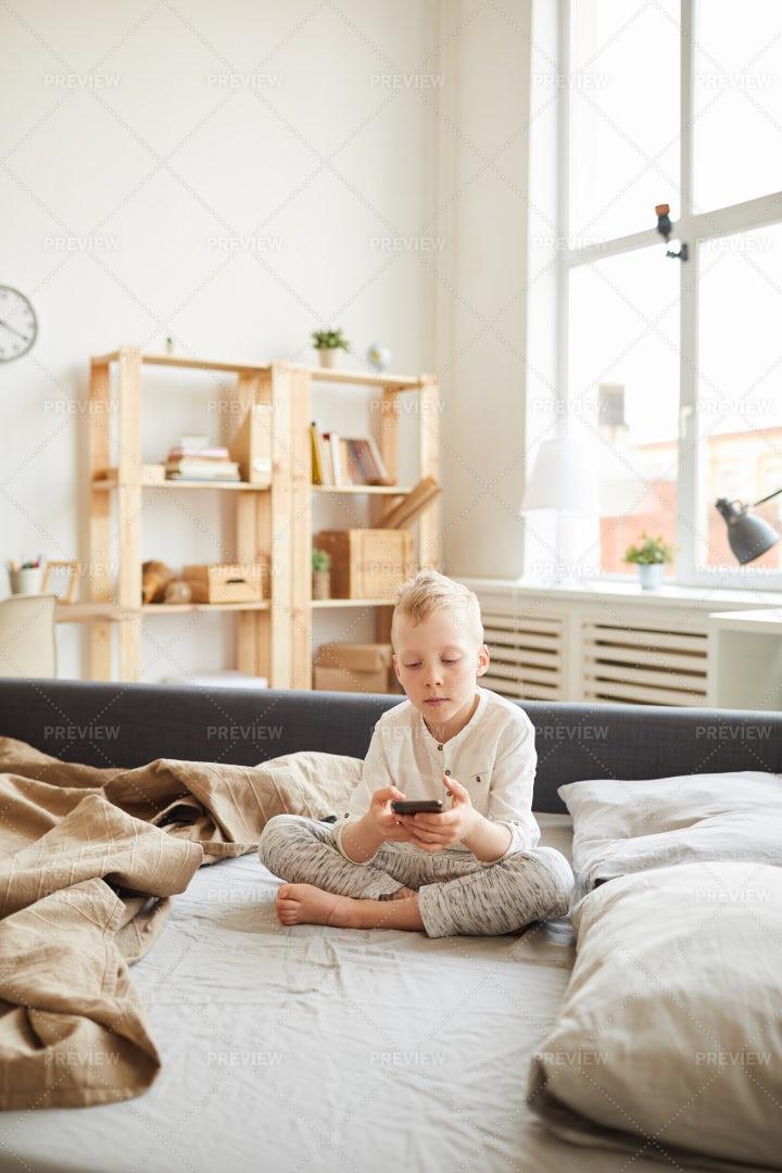 Gadget-addicted Kid At Home: Stock Photos