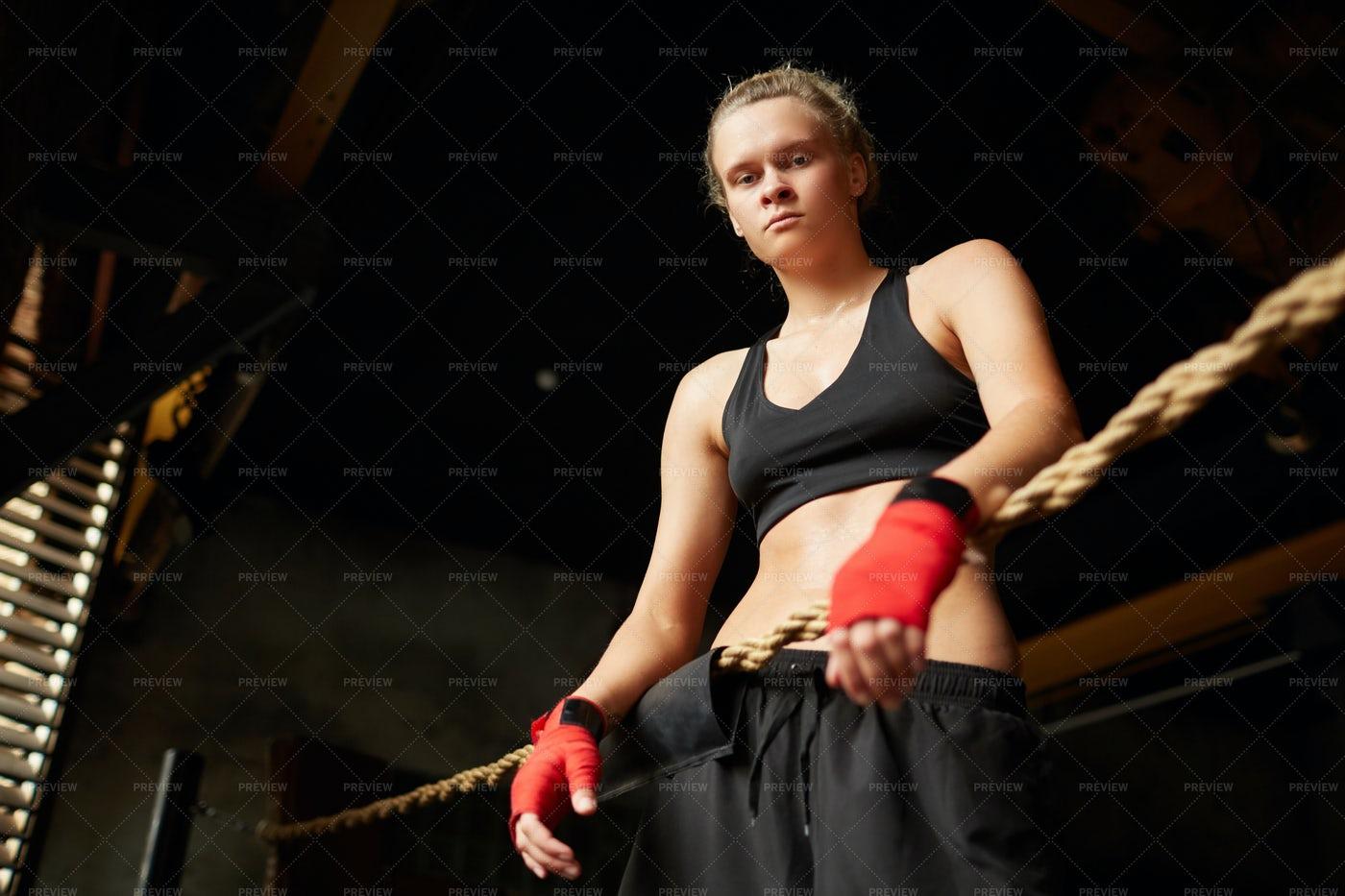 Tough Female Boxer Looking At...: Stock Photos