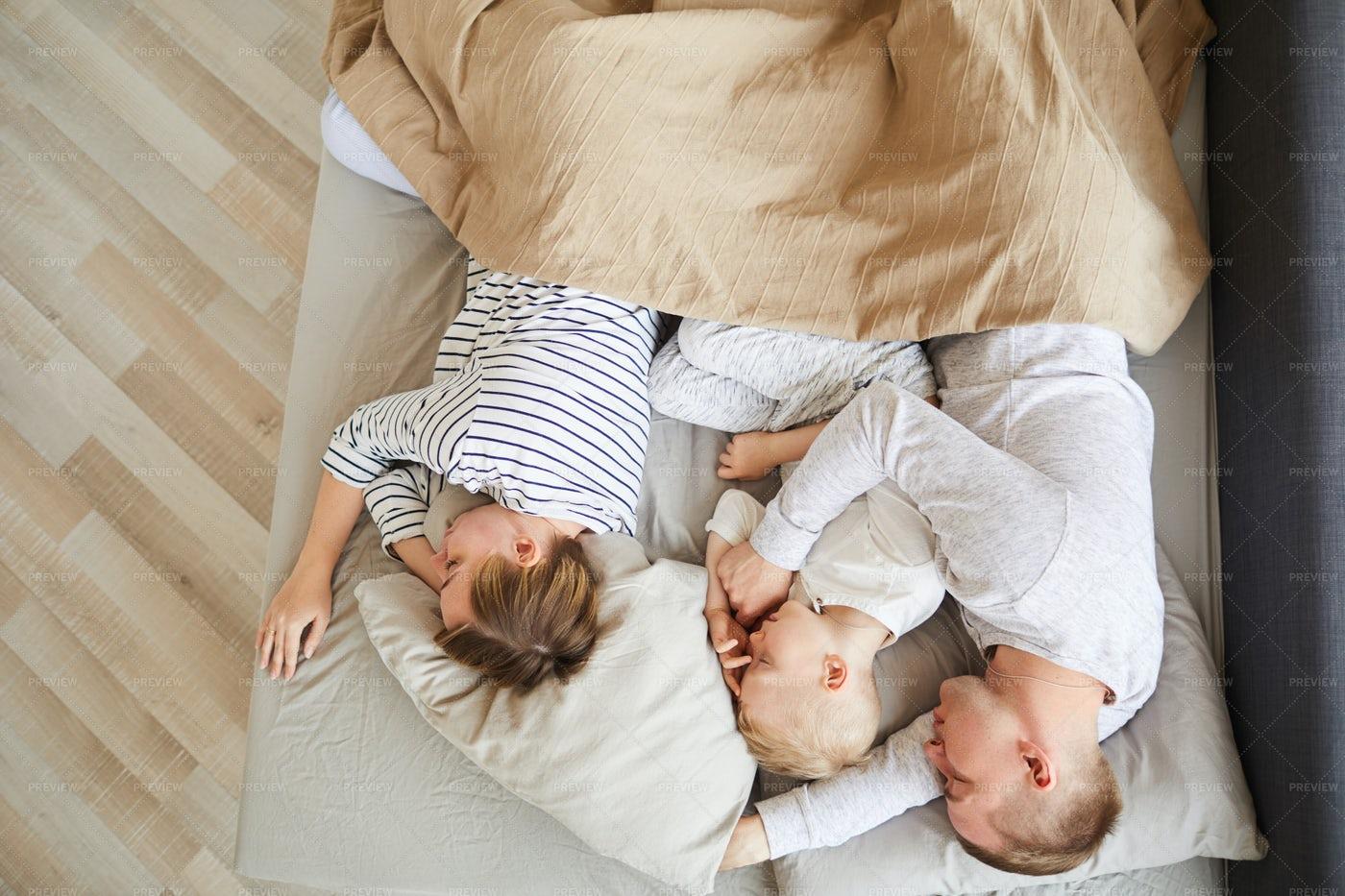 Family Sleeping On Comfortable...: Stock Photos