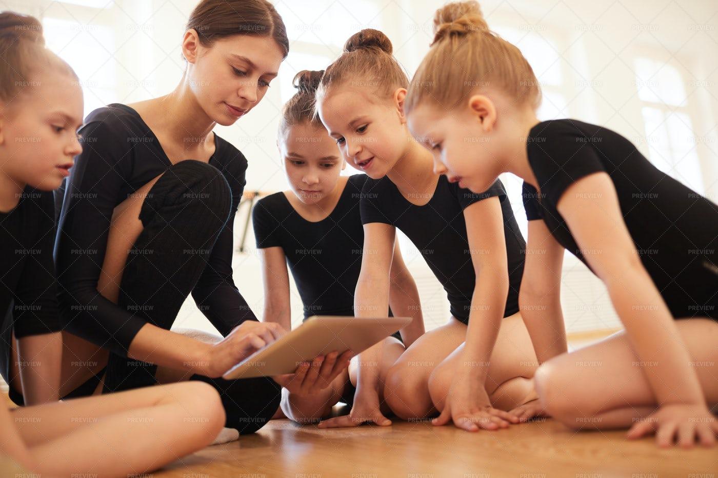 Watching Videos In Dance Class: Stock Photos