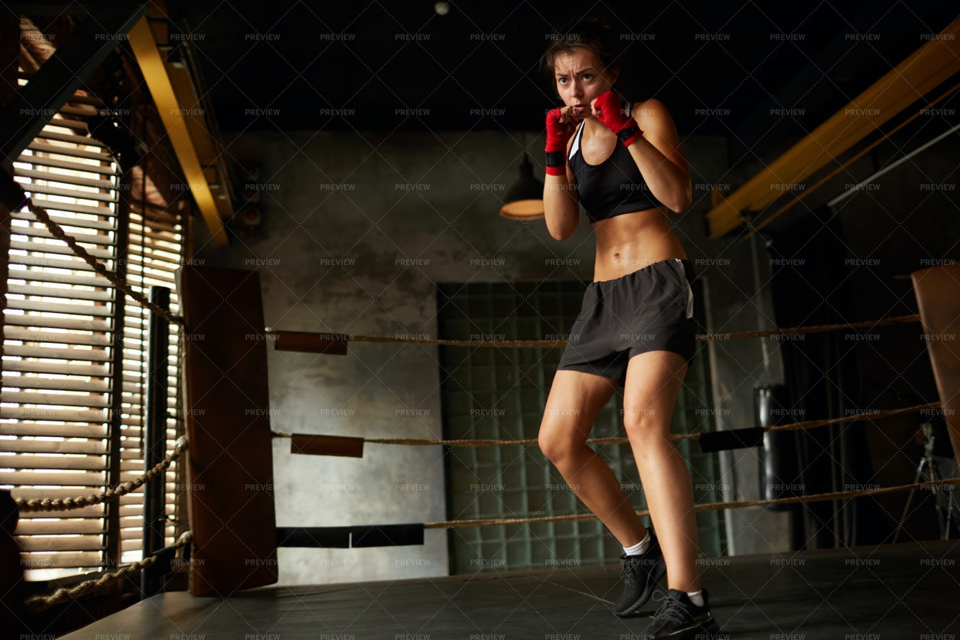 Tough Female Fighter In Boxing Ring: Stock Photos