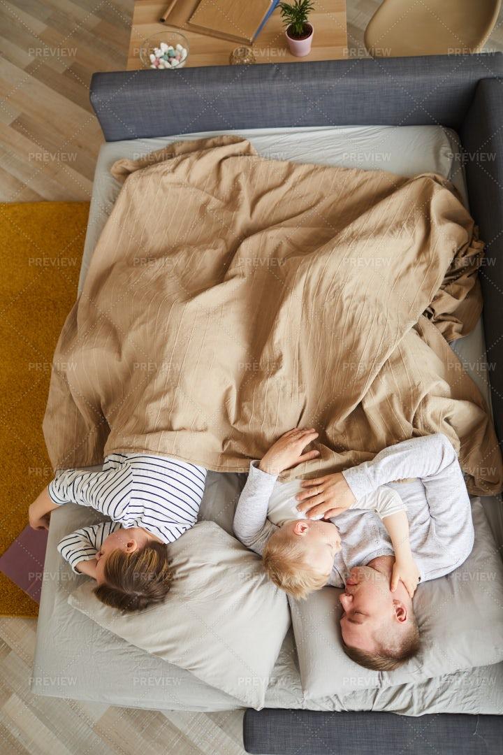 Family Sleeping On Sofa Bed: Stock Photos
