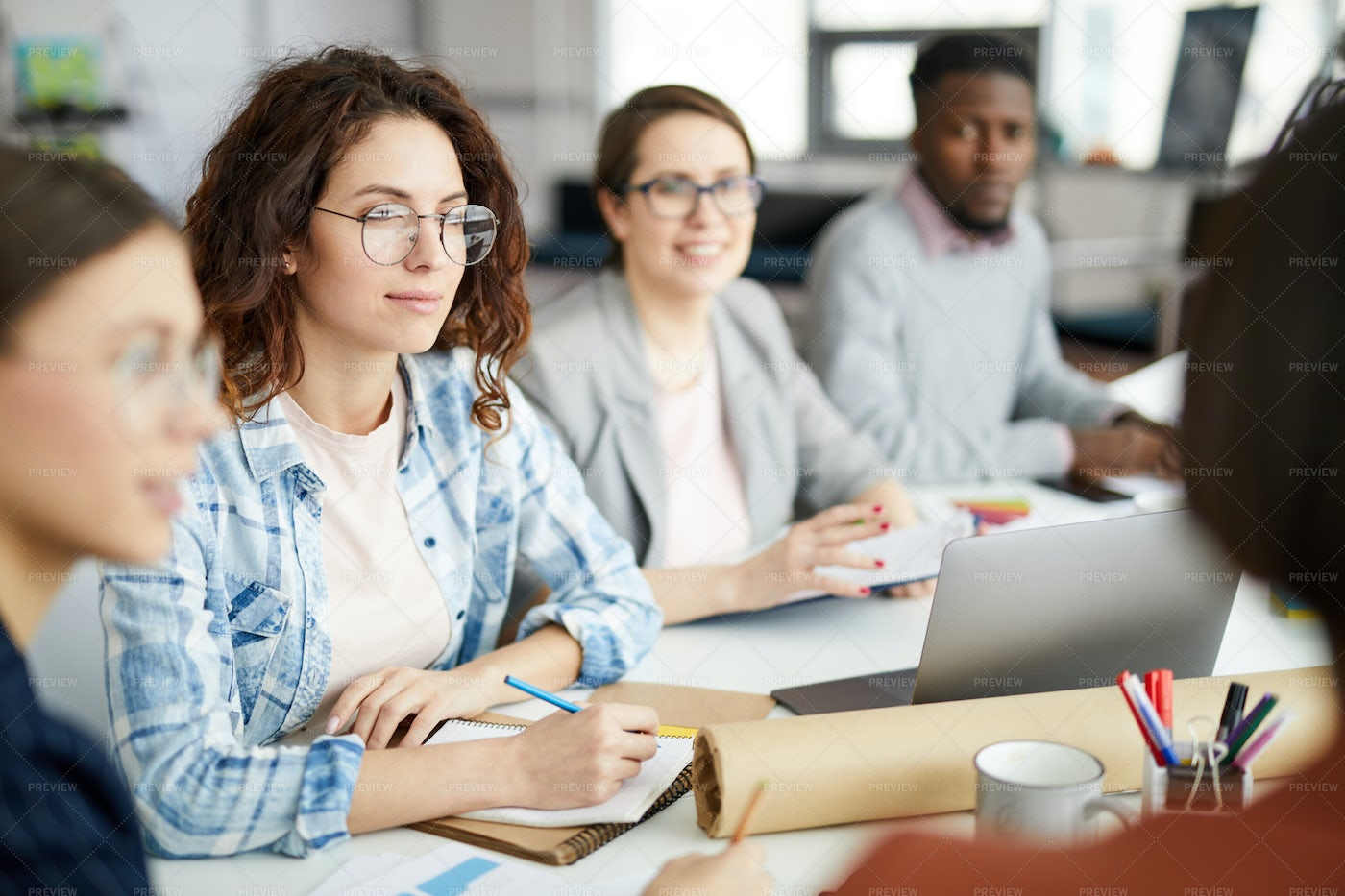 Contemporary Woman At Meeting Table: Stock Photos
