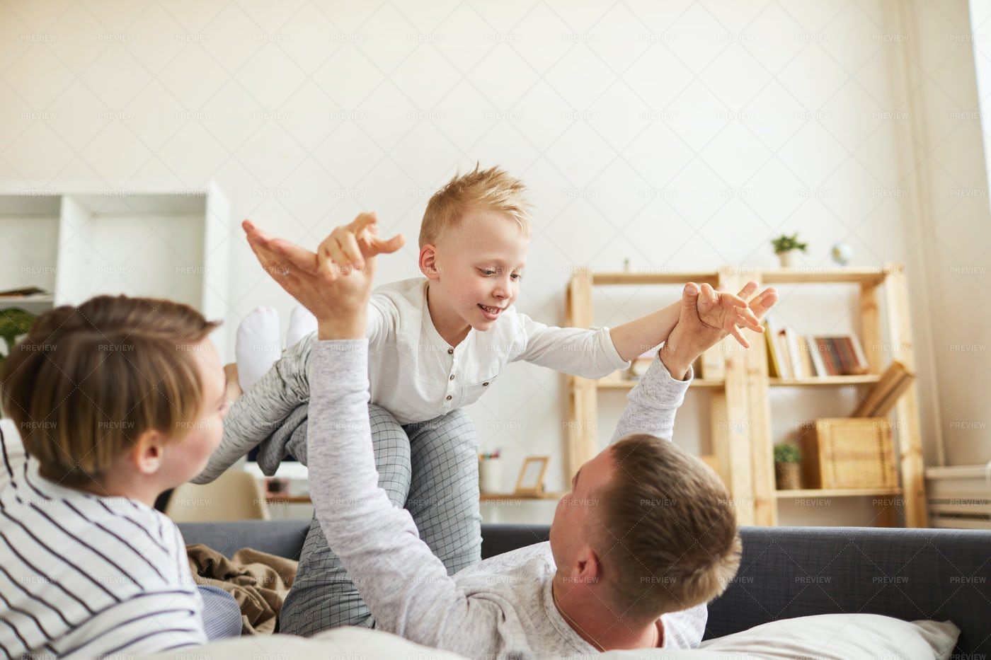 Playful Parents Having Fun With Son...: Stock Photos