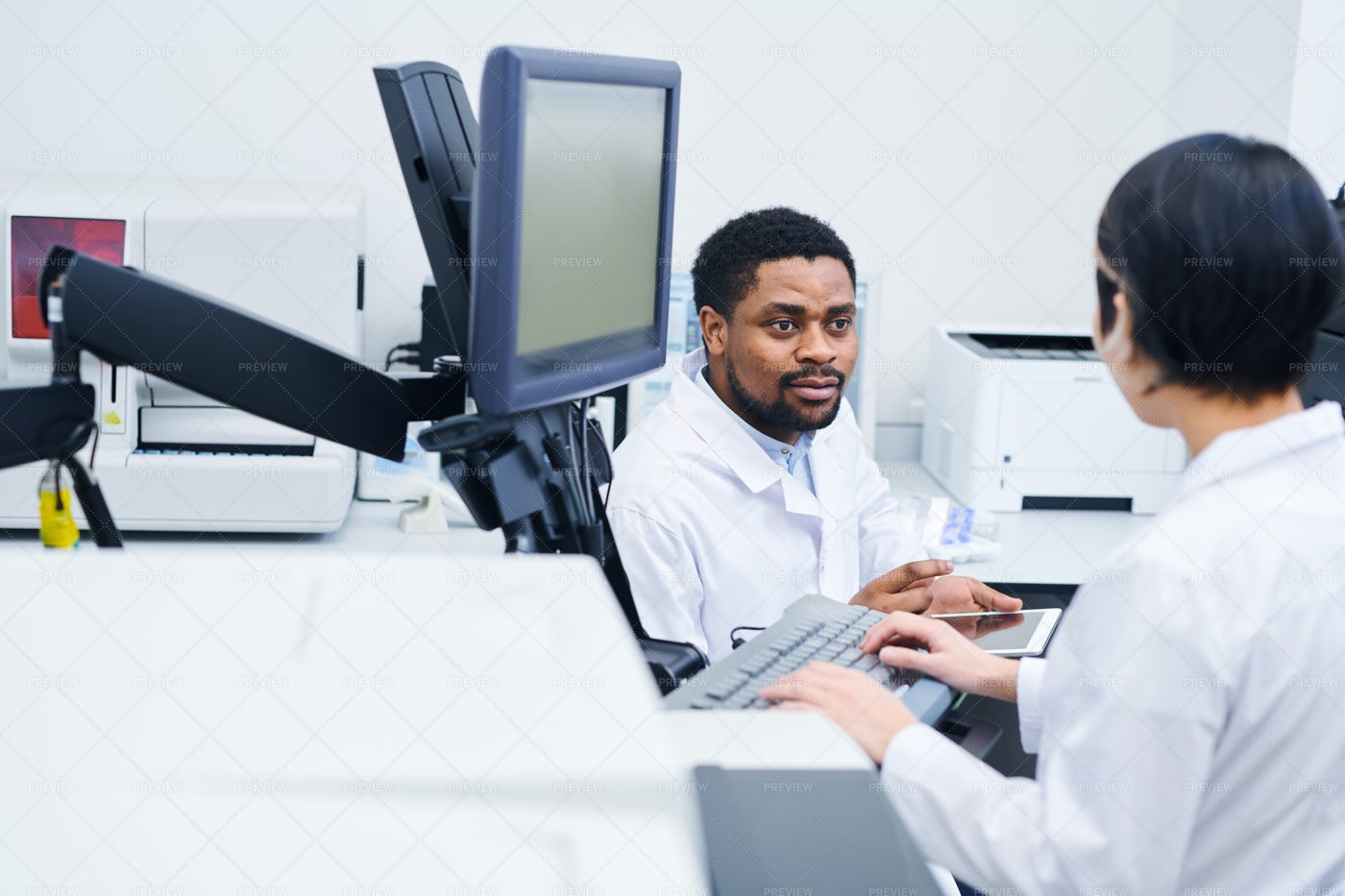 Laboratory Scientists Discussing...: Stock Photos