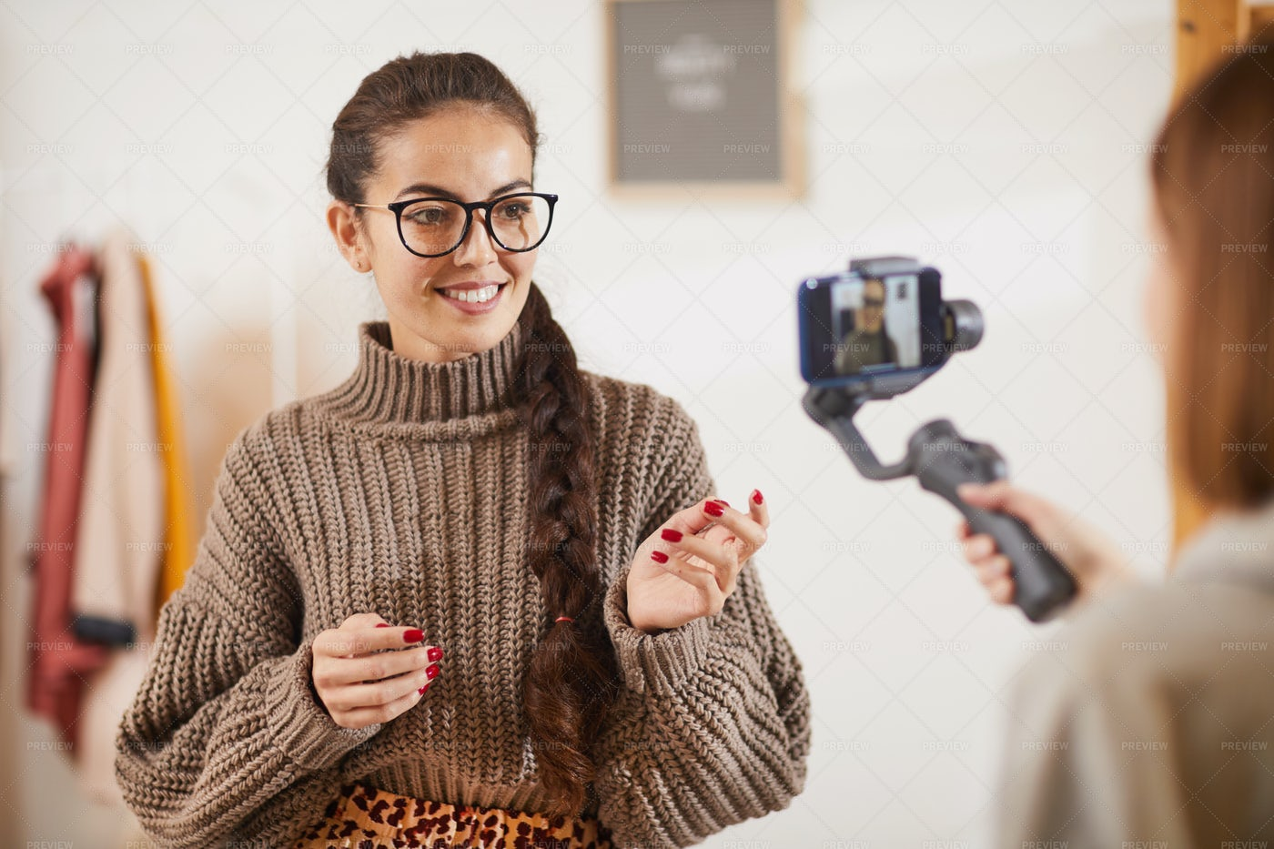 Smiling Young Woman Talking To...: Stock Photos