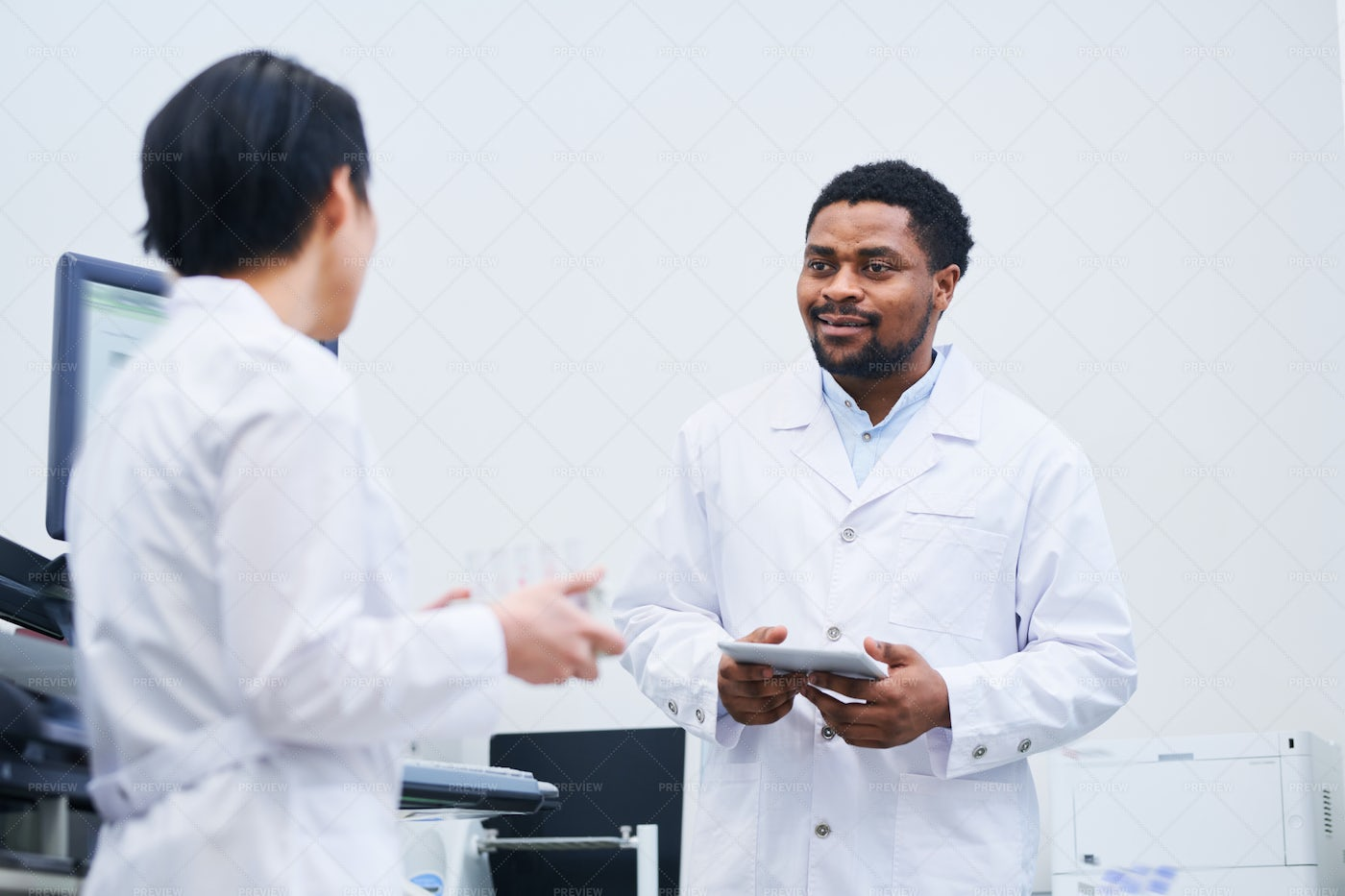 Medical Colleagues Talking In...: Stock Photos