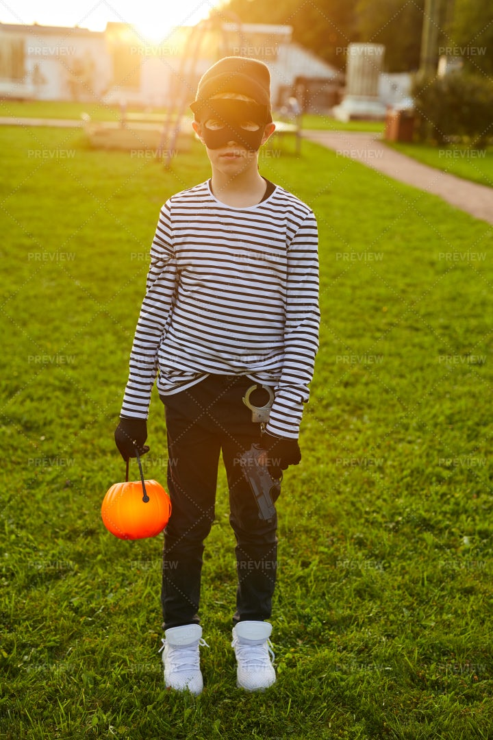 Tenage Boy Wearing Halloween...: Stock Photos