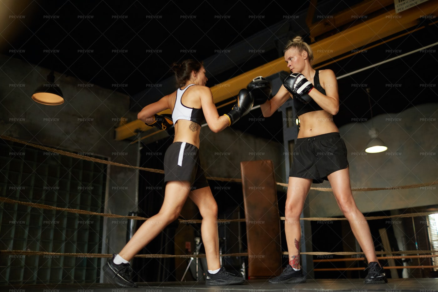 Two Female Boxers Fighting: Stock Photos