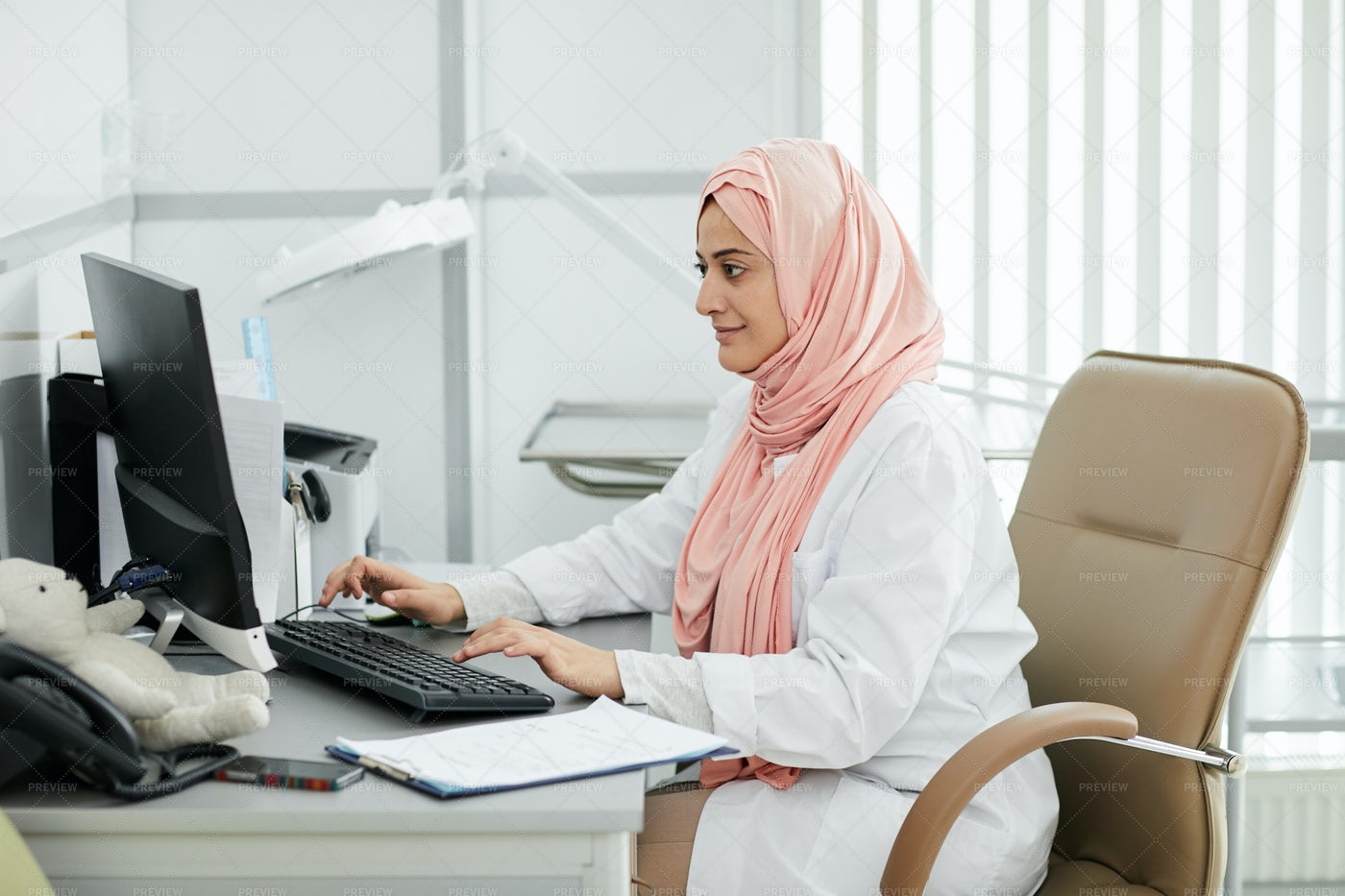 Middle-Eastern Female Doctor At...: Stock Photos