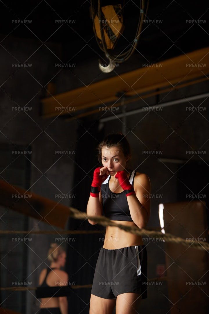 Tough Young Woman Boxing In Ring: Stock Photos