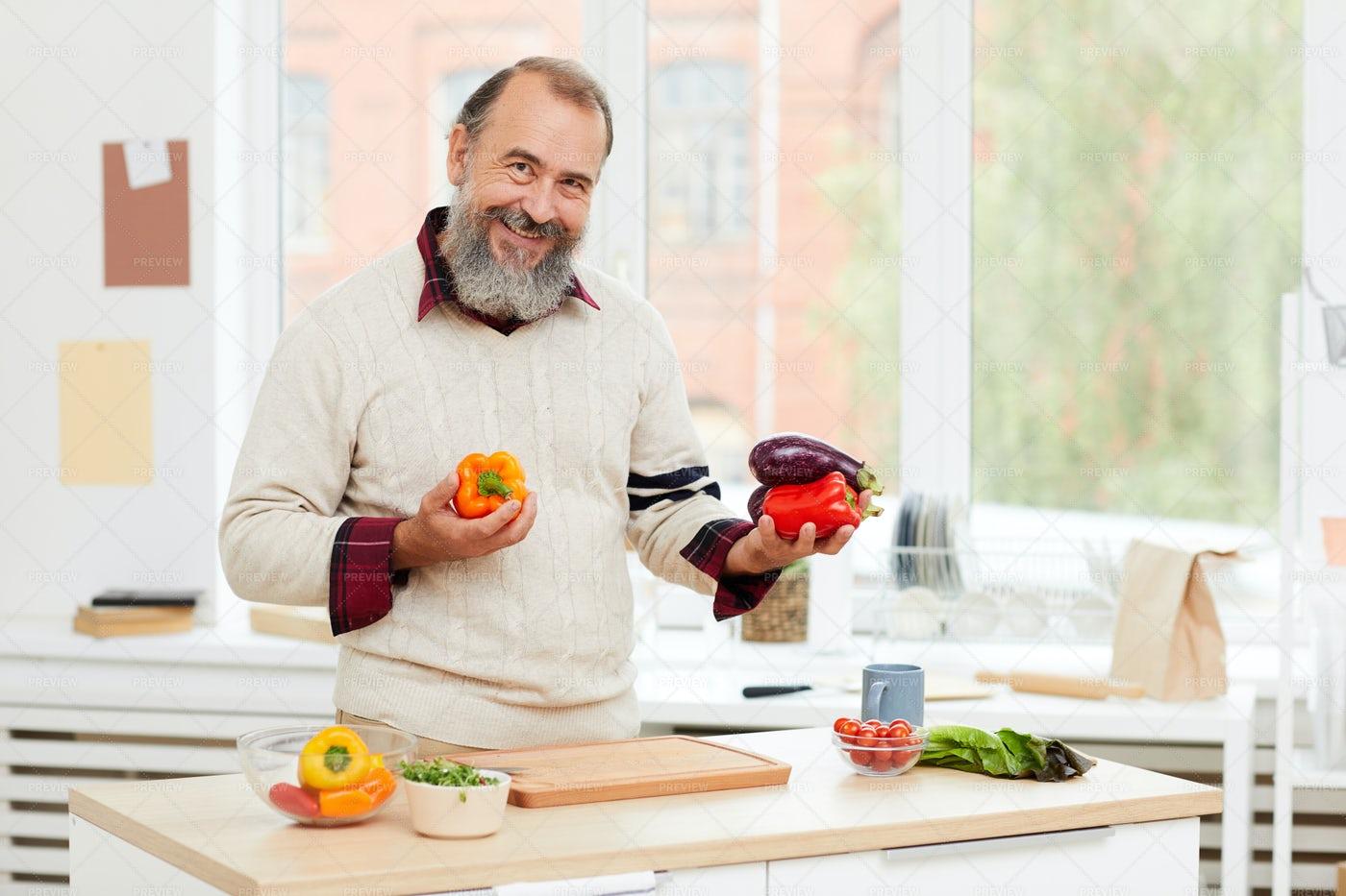 Smiling Senior Man Cooking: Stock Photos