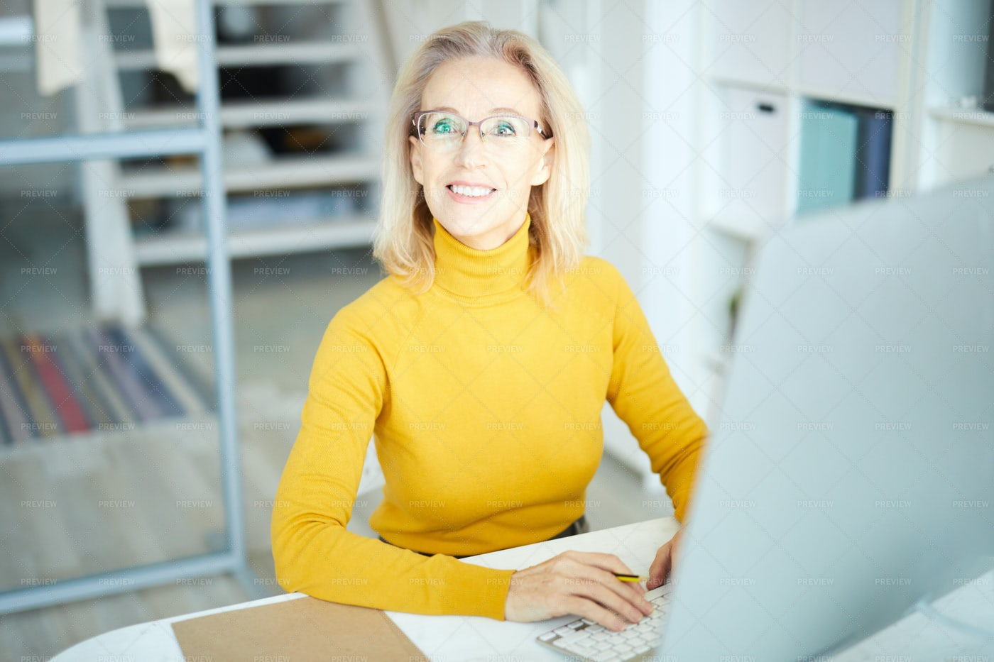 Mature Businesswoman Working: Stock Photos