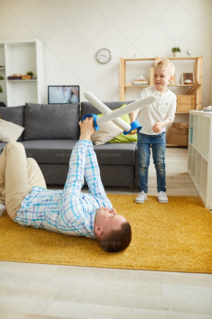 Father And Son Fighting With Toy...: Stock Photos