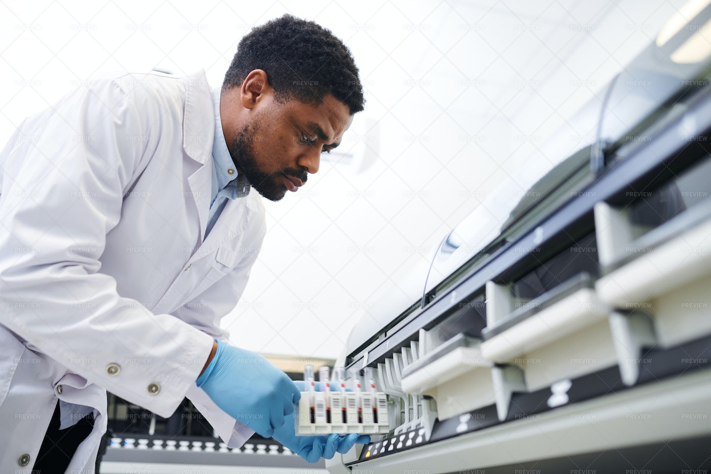 Black Doctor Working With...: Stock Photos