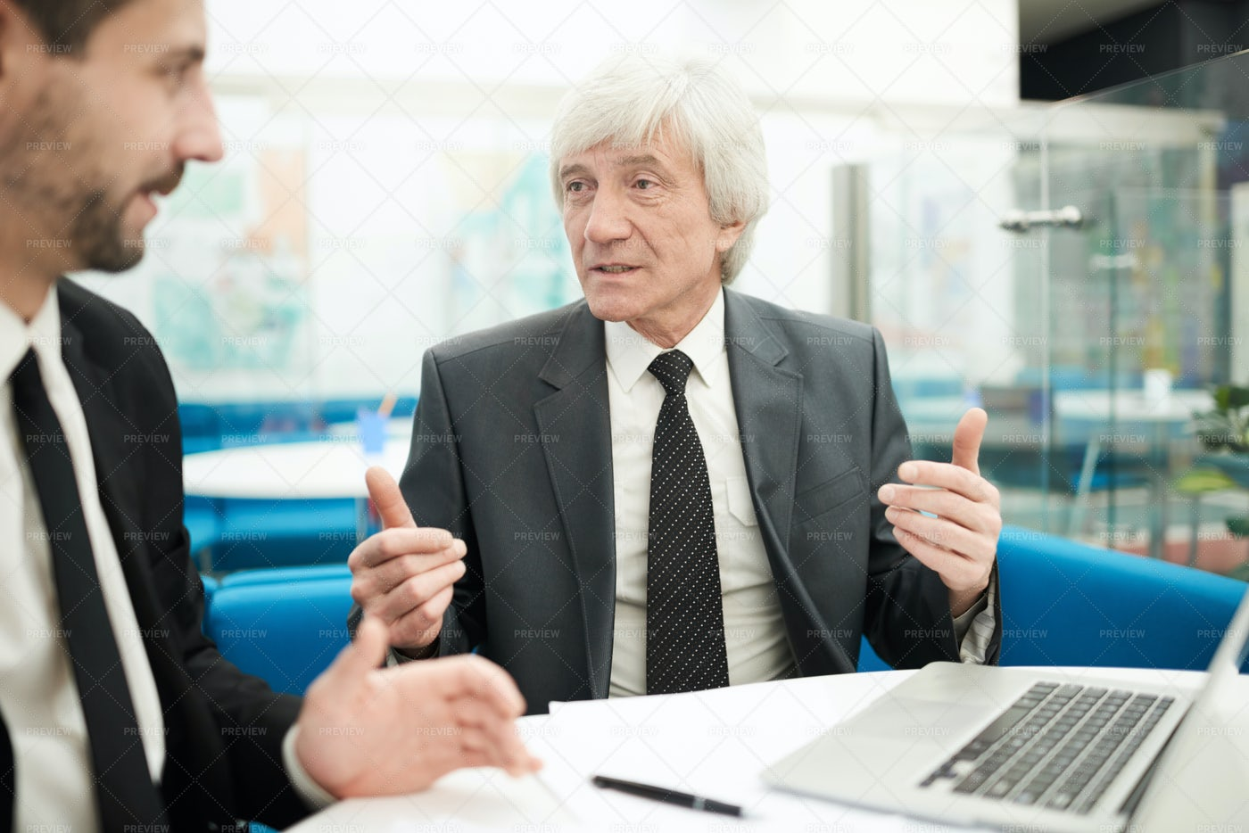 Senior Businessman In Meeting: Stock Photos
