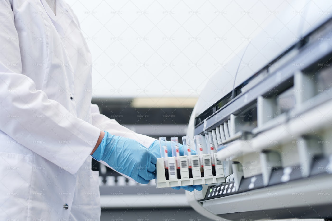 Putting Blood Samples Into Tube...: Stock Photos
