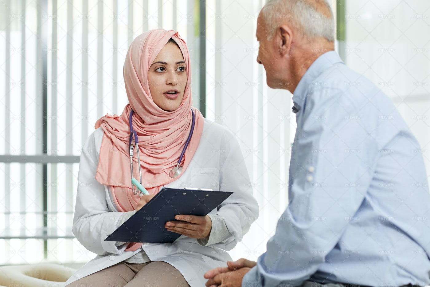 Middle-Eastern Doctor Talking To...: Stock Photos