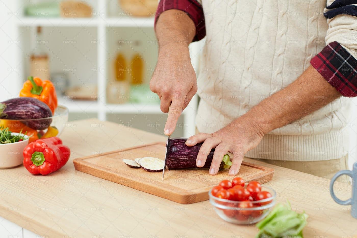 Senior Man Cutting Vegetables: Stock Photos