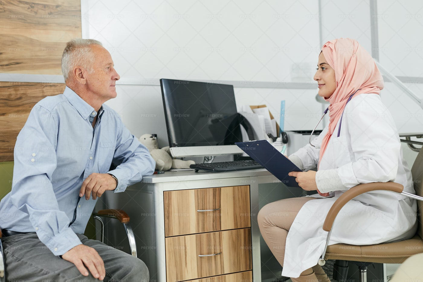 Middle-Eastern Female Doctor...: Stock Photos