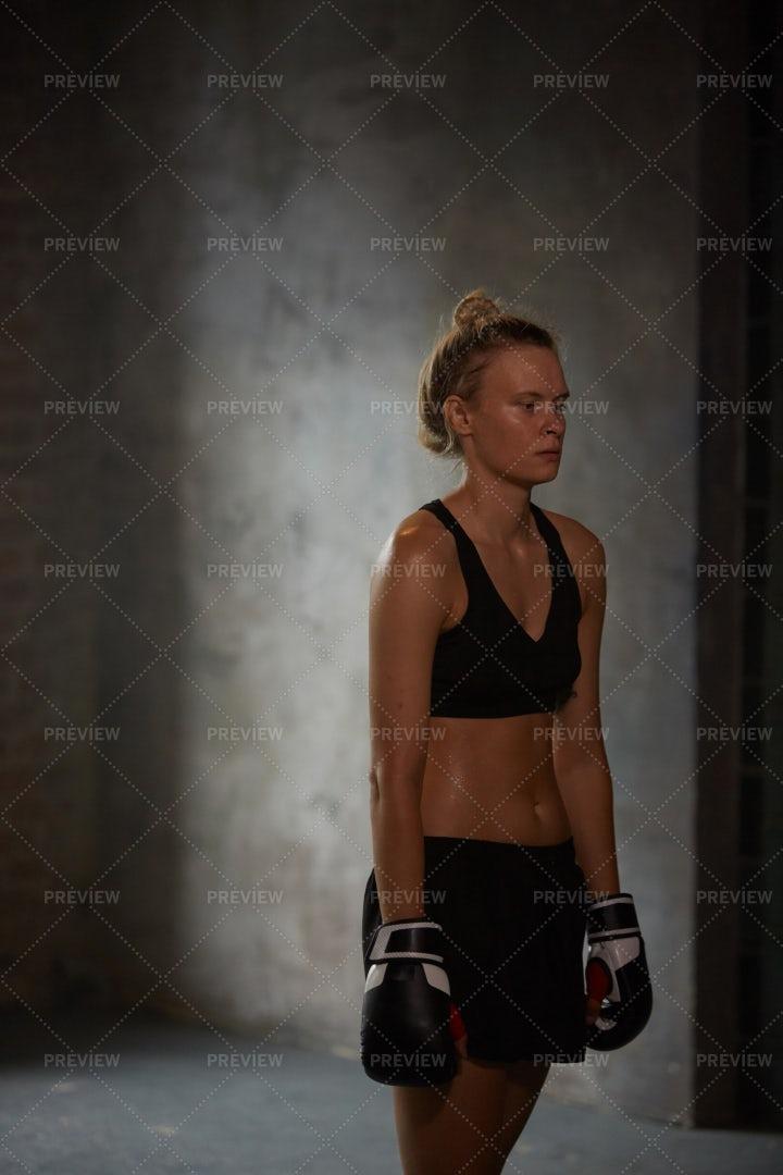 Female Boxer Training In Dark: Stock Photos