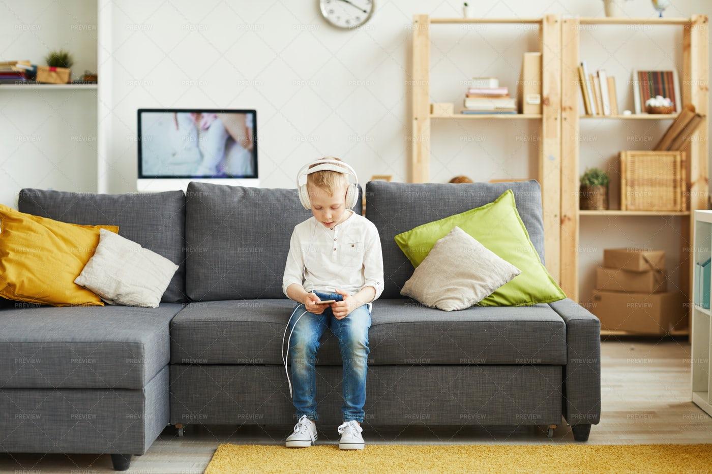 Adolescent Boy Choosing Music On...: Stock Photos