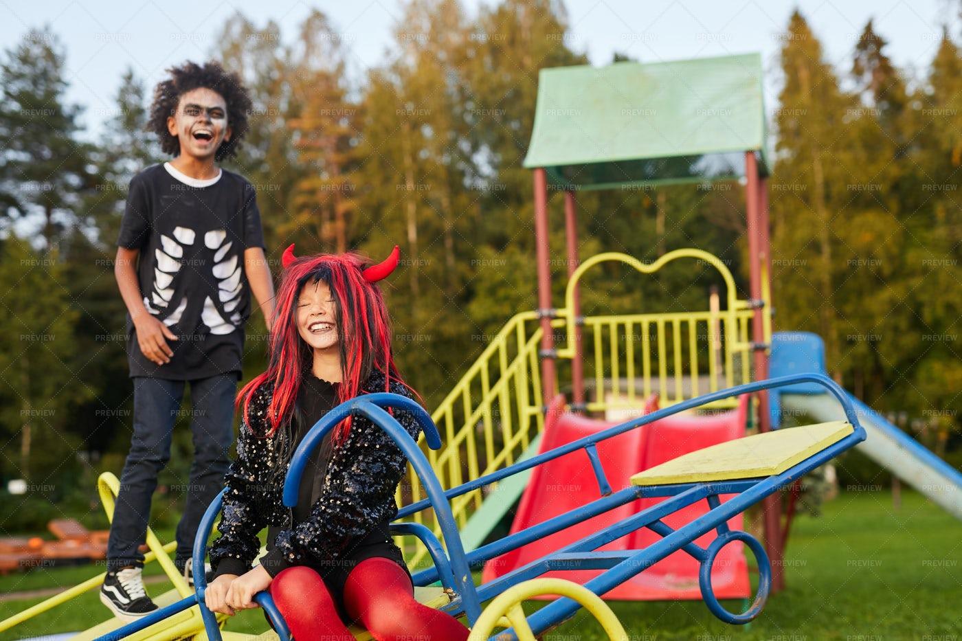 Halloween Kids On Playground: Stock Photos