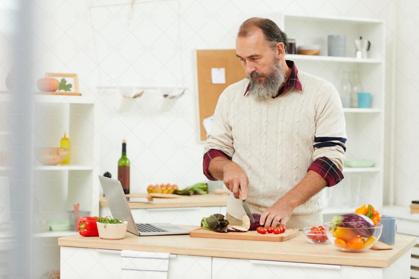 Senior Man Watching Cooking...: Stock Photos