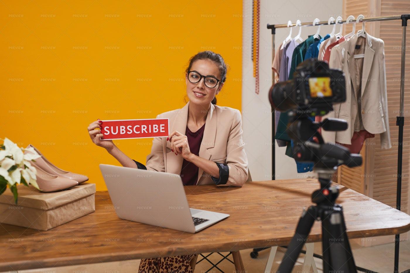 Fashio Blogger Holding Subscribe...: Stock Photos
