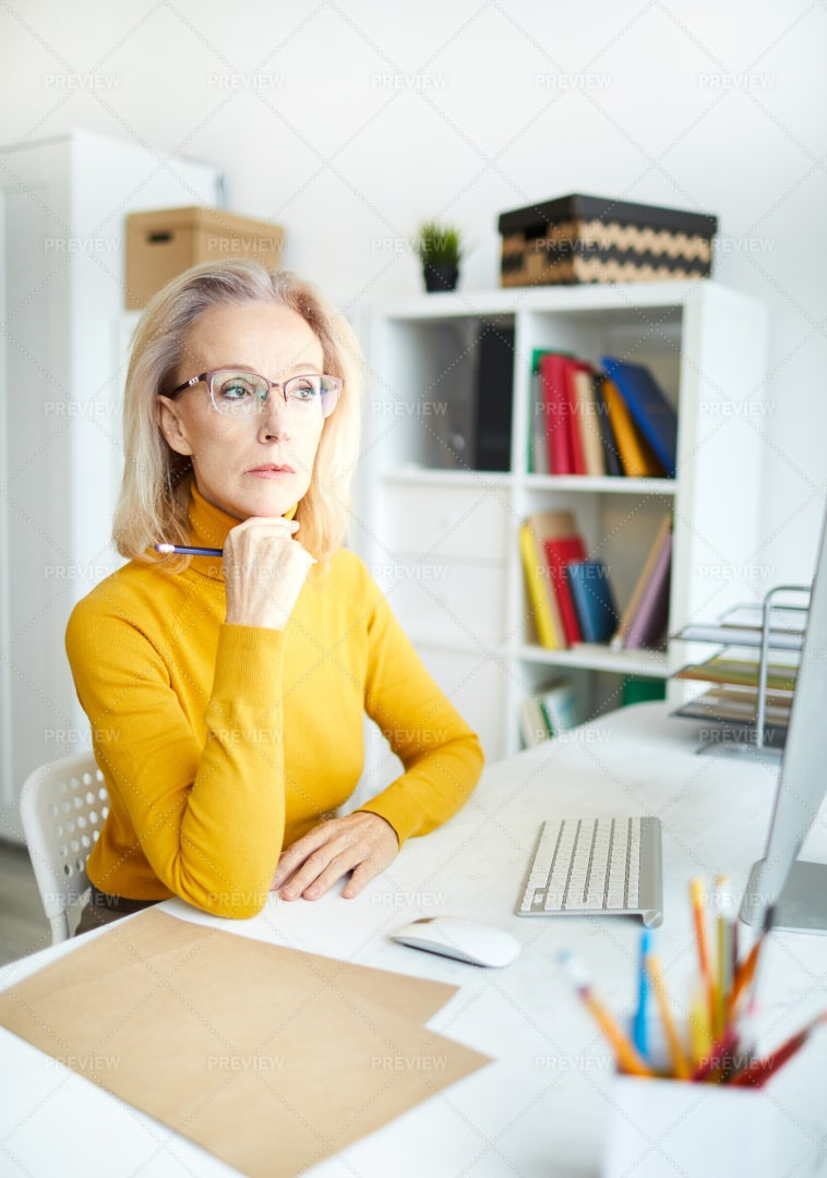 Pensive Female Manager: Stock Photos