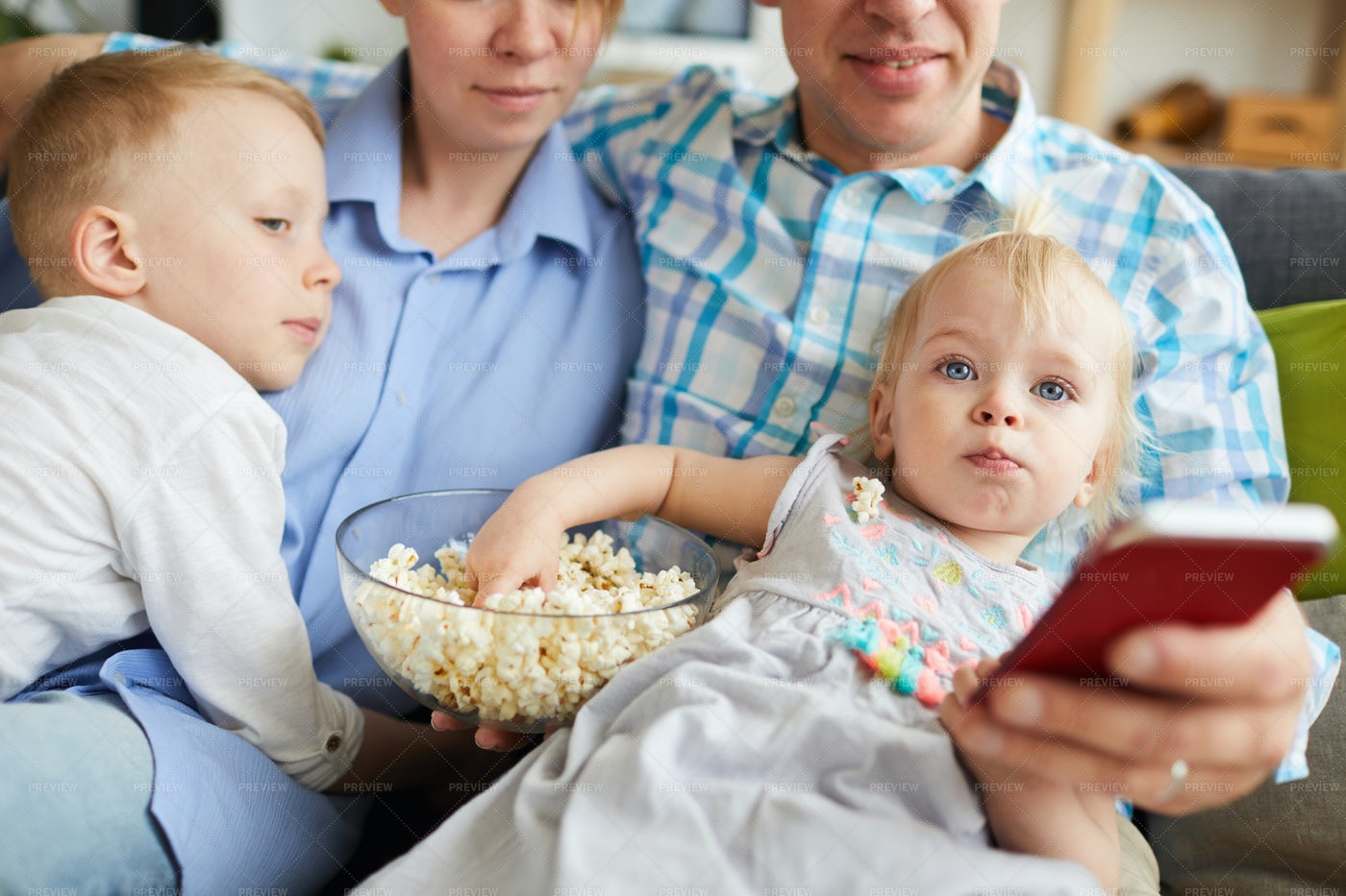 Family Watching Tv And Eating...: Stock Photos