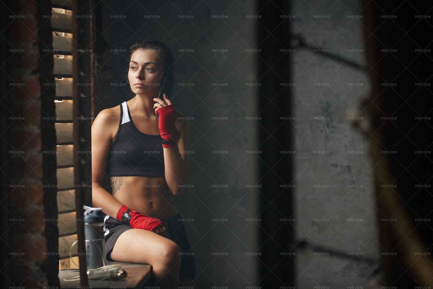 Tough Young Woman By Window: Stock Photos