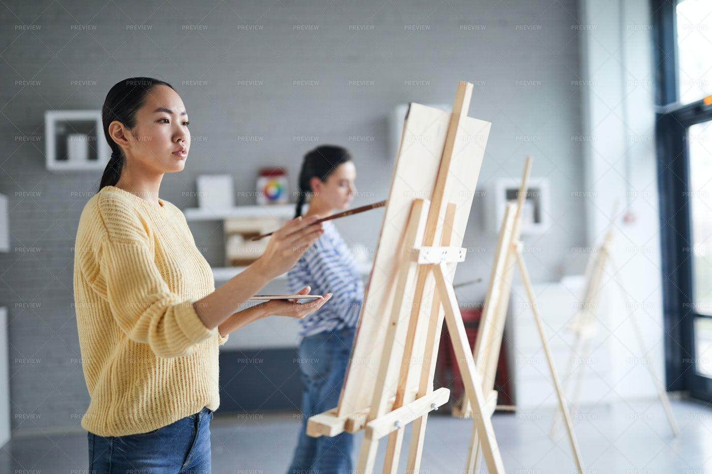 Girl Painting: Stock Photos