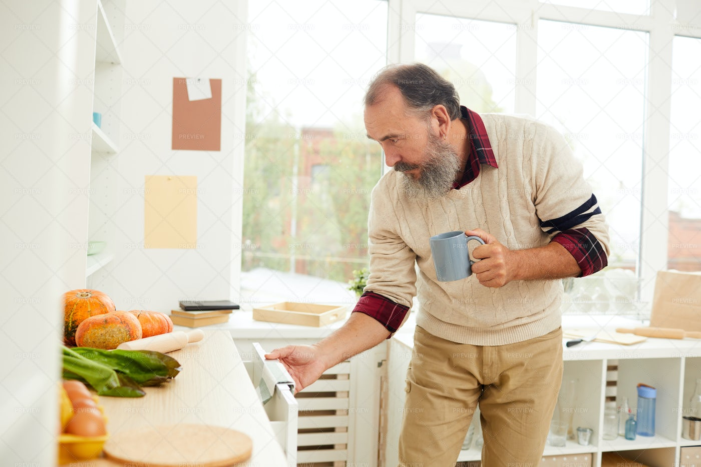 Senior Man Looking For Food In...: Stock Photos