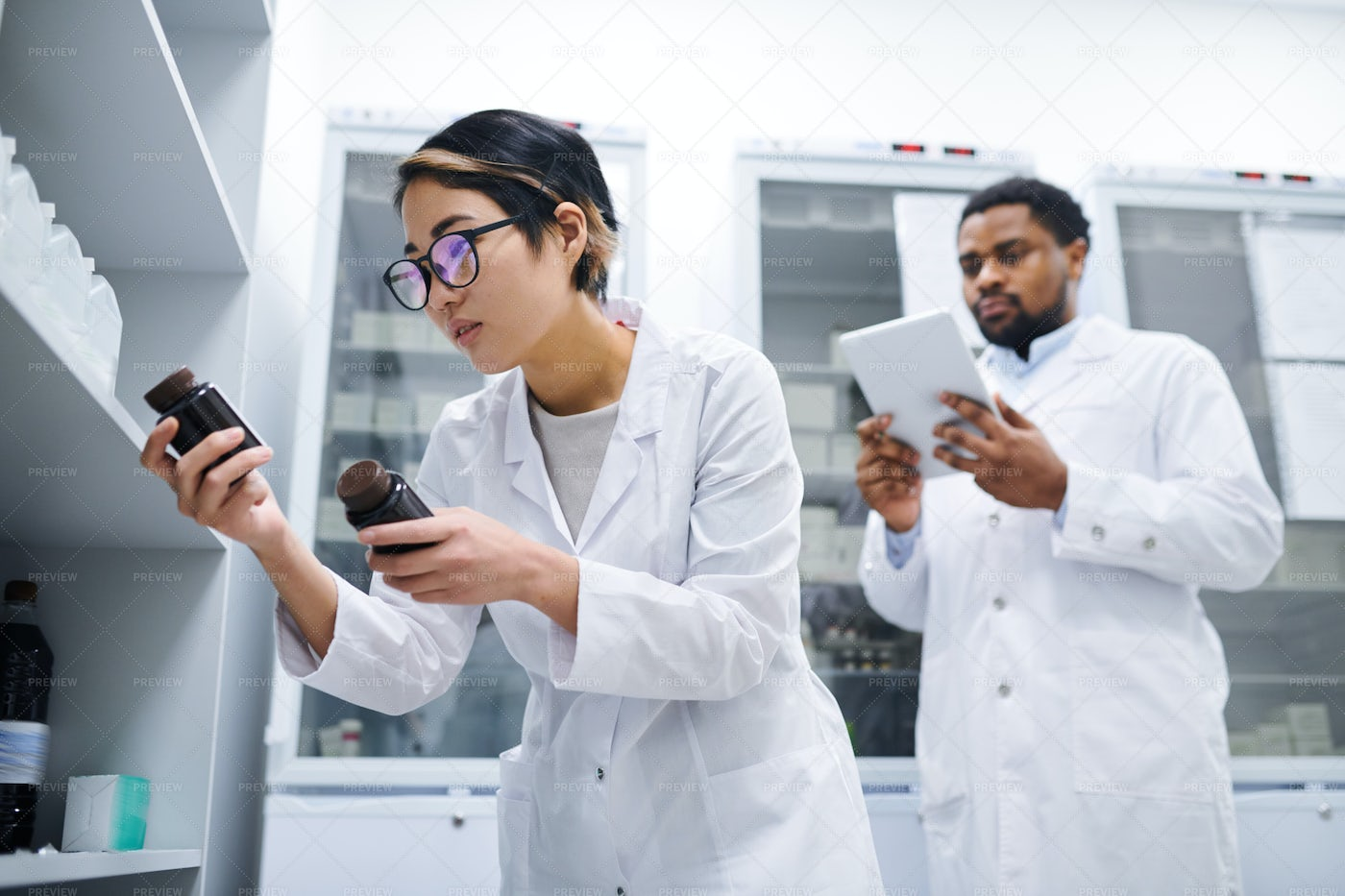 Lady Doctor Checking Medications: Stock Photos