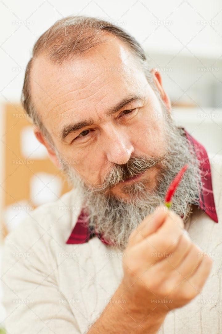 Senior Man Holding Hot Pepper: Stock Photos