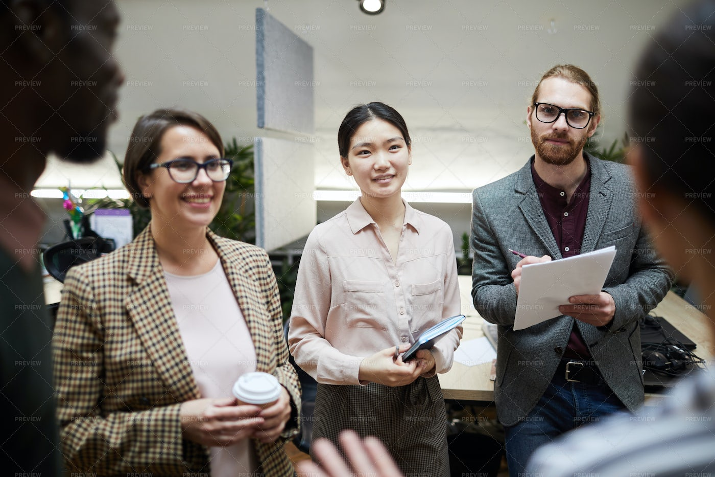 Business People Talking In Office: Stock Photos