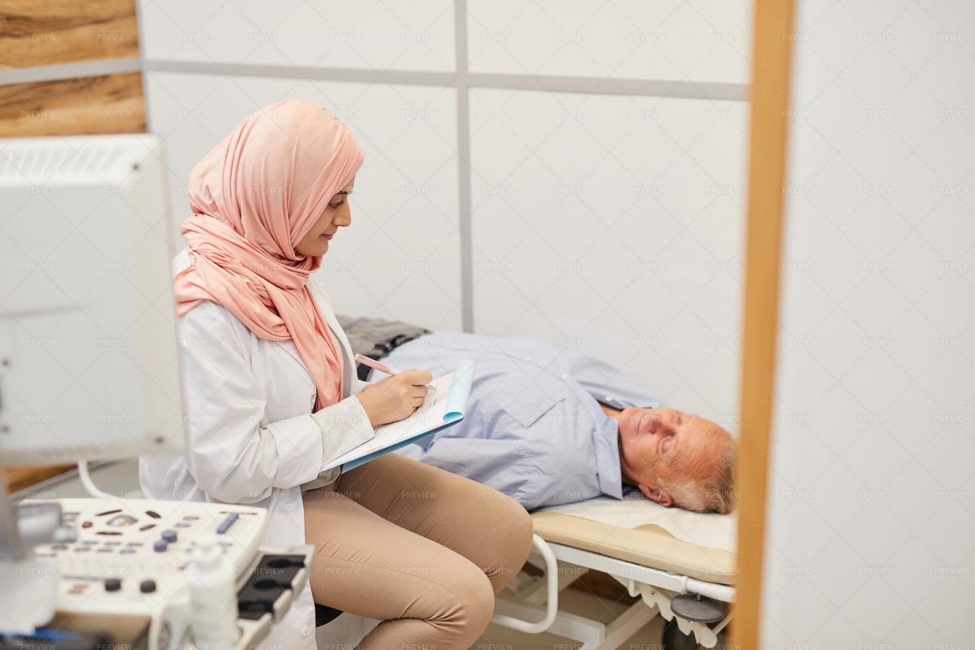 Arab Nurse Filling In Patients Form: Stock Photos