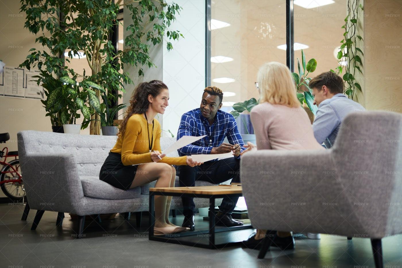 Creative Team Discussing Sales...: Stock Photos