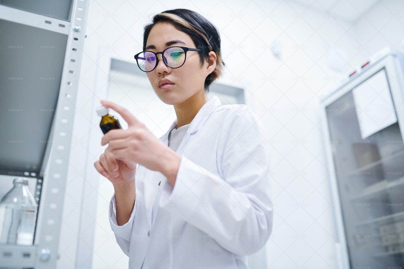 Asian Pharmacist Checking Pill...: Stock Photos