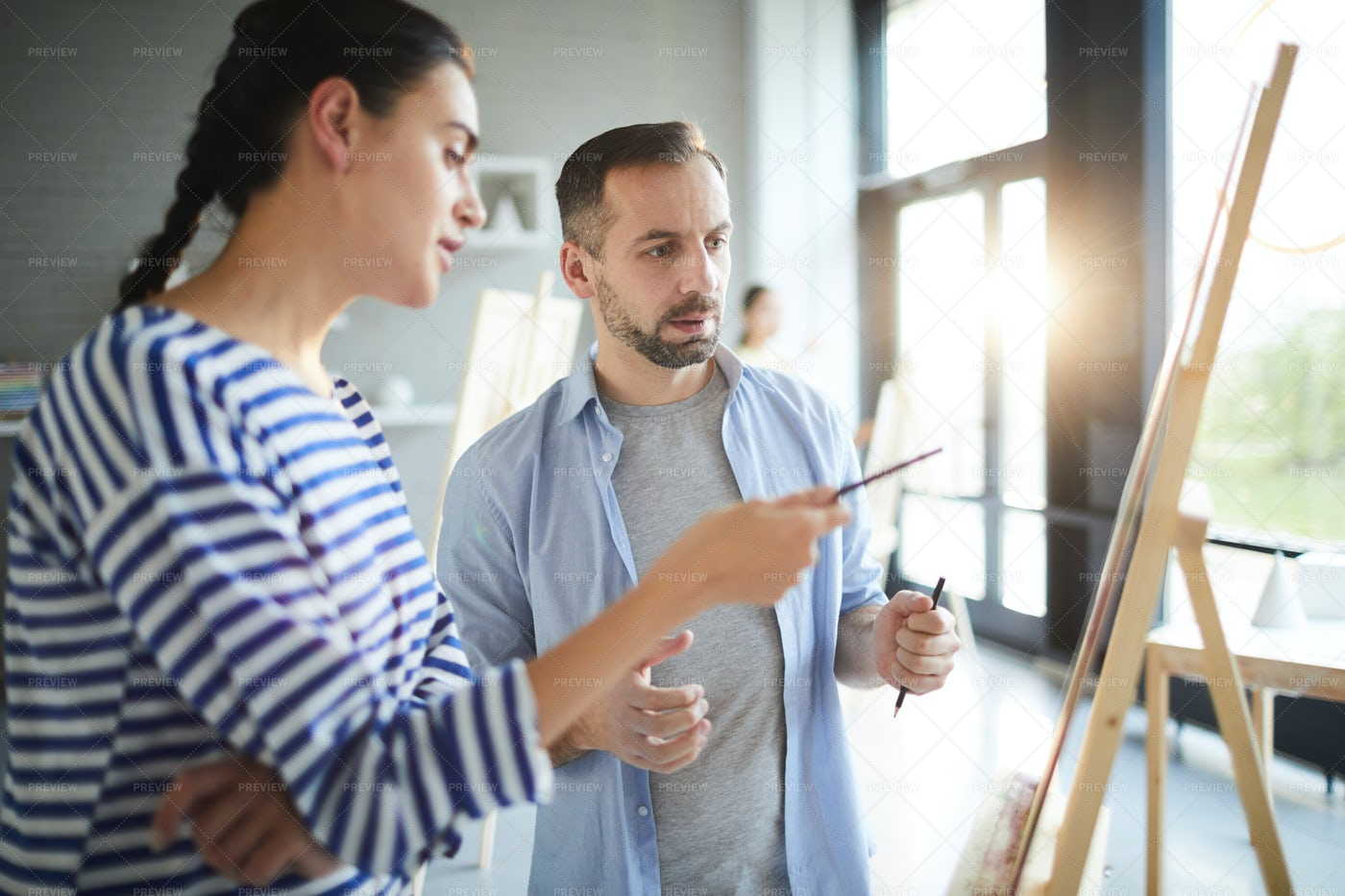 Conversation By Easel: Stock Photos