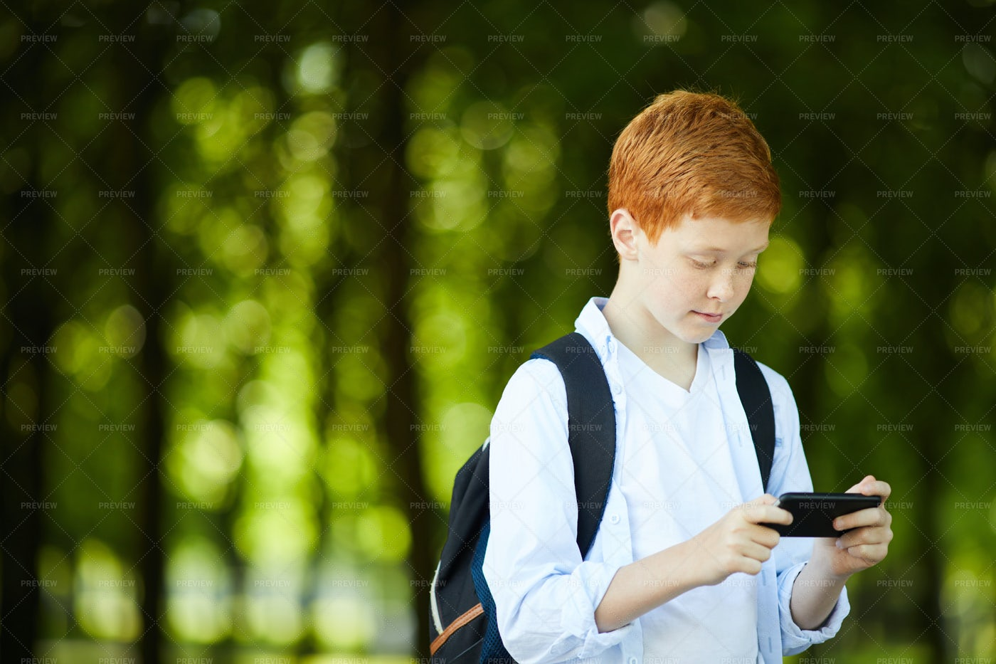 Schoolboy Playing With Phone: Stock Photos