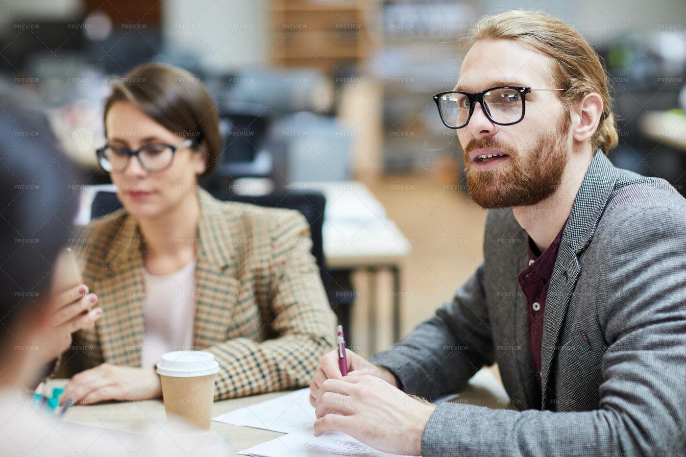 Businessman Sharing Ideas At...: Stock Photos