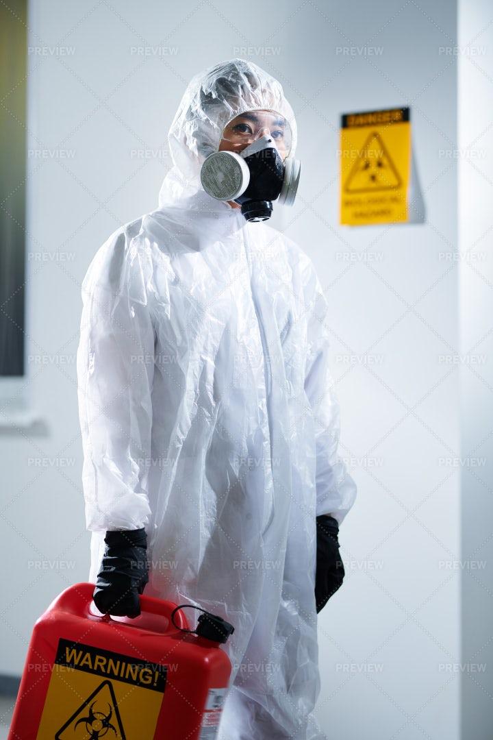 Laboratory Worker In Biohazard Suit: Stock Photos